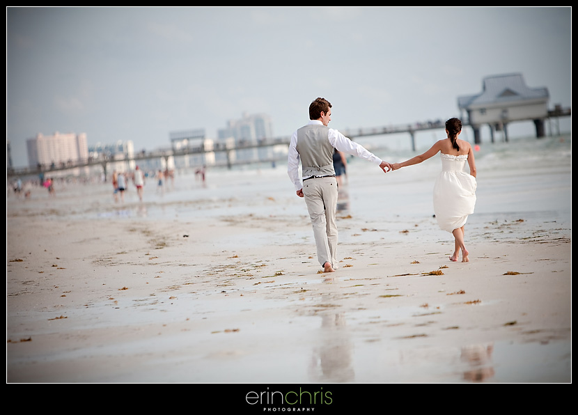 Wedding Photo Walking on Clearwater Beach Near the Pier