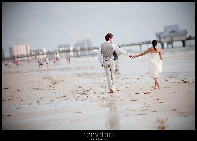Wedding Photo Walking on Clearwater Beach Near the Pier