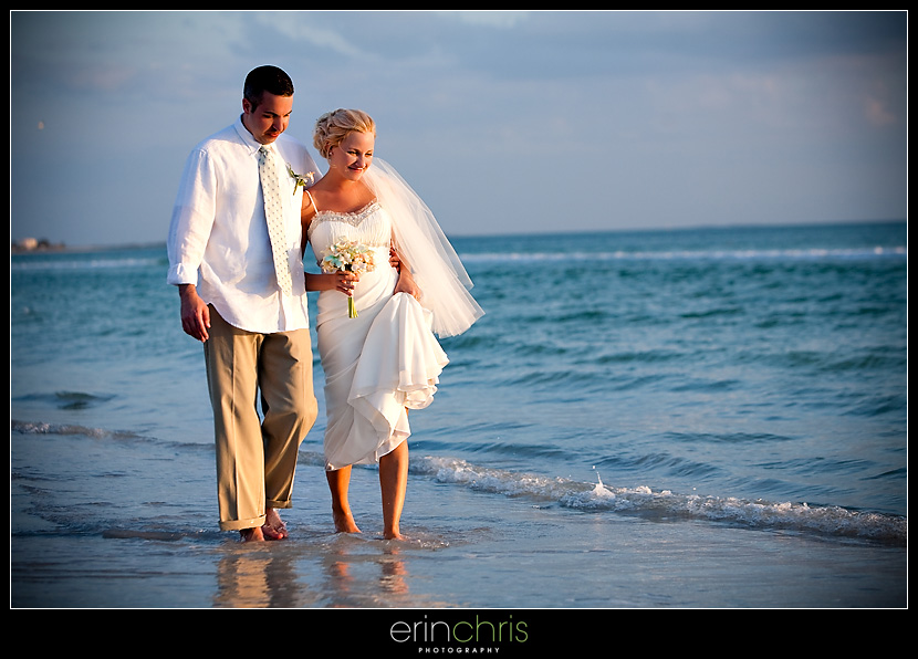 Wedding picture of bride and groom walking on the beach